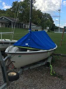 Dinghy sailboat with boom cover